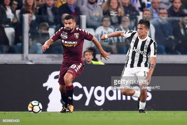 Tomas Rincon and Paulo Dybala during the Serie A match between Juventus and Torino FC on September 23 2017 in Turin Italy