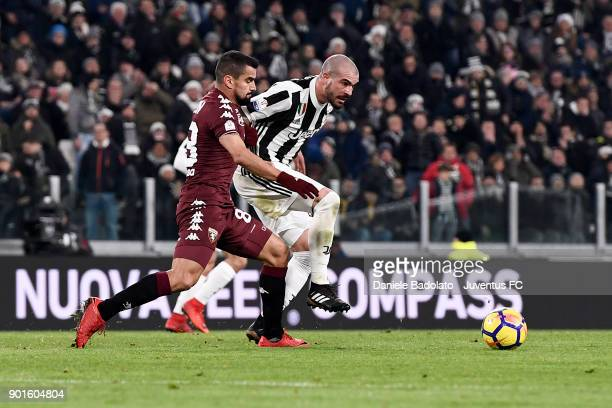 Tomas Rincon and Stefano Sturaro during the TIM Cup match between Juventus and Torino FC at Allianz Stadium on January 3 20