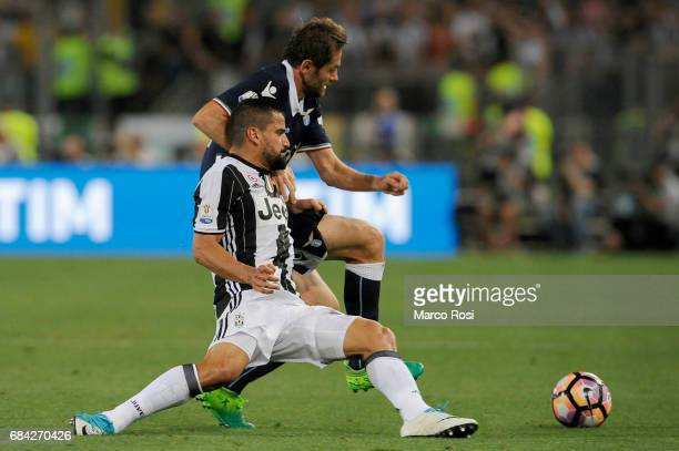 Tomas Rincon of FC Juventus compete for the ball with Senad Lulic of SS Lazio during the TIM Cup Final match between SS Lazio and Juventus FC at...