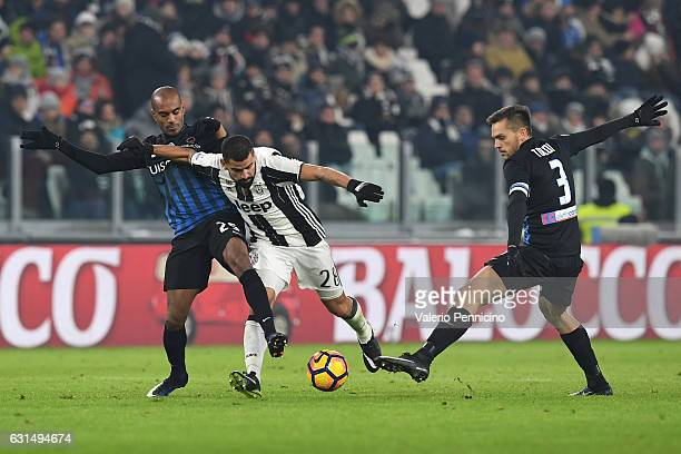 Tomas Rincon of FC Juventus is challenged by Rafael Toloi and Abdoulay Konko of Atalanta BC during the TIM Cup match between FC Juventus and Atalanta...