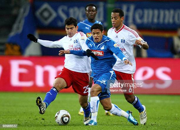Tomas Rincon of Hamburg and Carlos Eduardo of Hoffenheim battle for the ball during the Bundesliga match between Hamburger SV and 1899 Hoffenheim at...