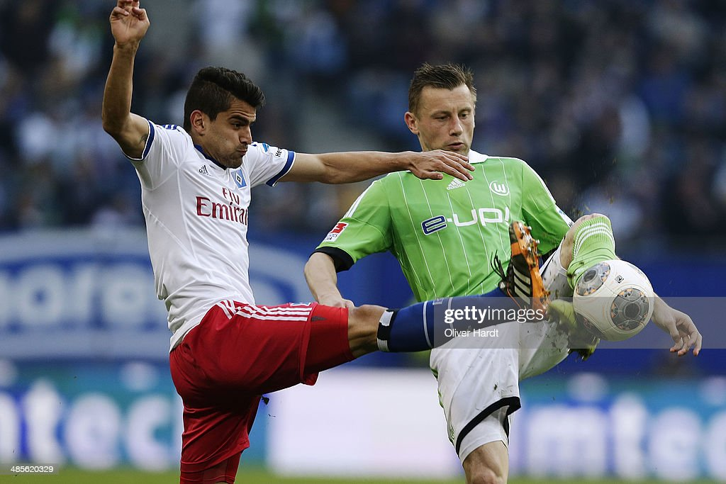 Tomas Rincon (L) of Hamburg and Ivica Olic (R) of Wolfsburg compete for the ball during the Bundesliga match between Hamburger SV and VfL Wolfsburg at Imtech Arena on April 19, 2014 in Hamburg, Germany.