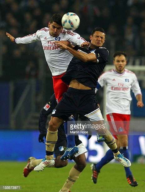 Tomas Rincon of Hamburg and Sejad Salihovic of Hoffenheim head for the ball during the Bundesliga match between Hamburger SV and 1899 Hoffenheim at...