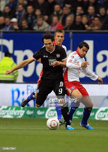 Tomas Rincon of Hamburg and Srdjan Lakic of Kaiserslautern compete for the ball during the Bundesliga match between Hamburger SV and 1 FC...