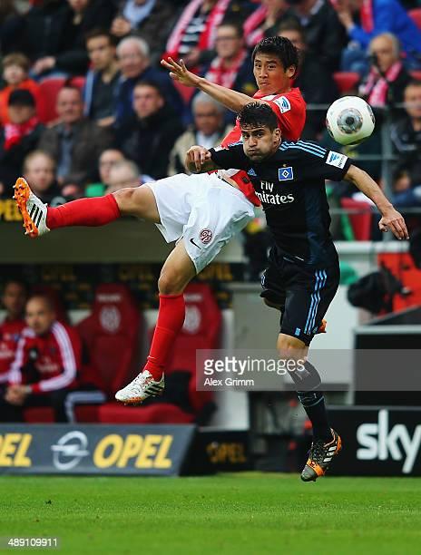 Tomas Rincon of Hamburg is challenged by JaCheol Koo of Mainz during the Bundesliga match between 1 FSV Mainz 05 and Hamburger SV at Coface Arena on...