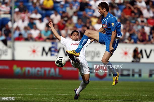 Tomas Rincon of Hamburg is challenged by Vedad Ibisevic of Hoffenheim during the Bundesliga match between 1899 Hoffenheim and Hamburger SV at the...