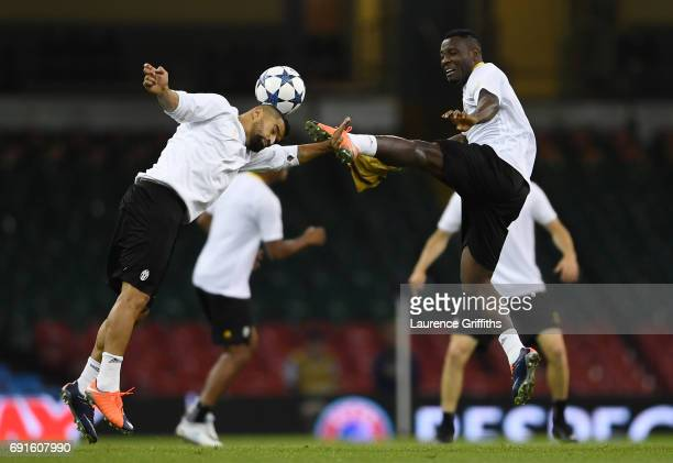 Tomas Rincon of Juventus and Kwadwo Asamoah of Juventus battle for possession during a Juventus training session prior to the UEFA Champions League...