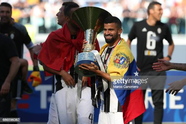 Tomas Rincon of Juventus FC celebrate the victory of Italian Serie A with championship trophy and Venezuela's flag after the match between Juventus...