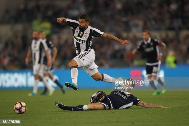 Tomas Rincon of Juventus FC competes for the ball with Luis Alberto of SS Lazio during the TIM Cup Final match between SS Lazio and Juventus FC at...