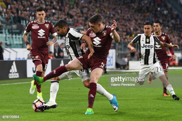 Tomas Rincon of Juventus FC is challenged by Andrea Belotti of FC Torino during the Serie A match between Juventus FC and FC Torino at Juventus...