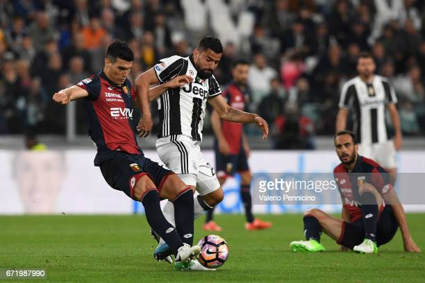 Tomas Rincon of Juventus FC is challenged by Ezequiel Munoz of Genoa CFC during the Serie A match between Juventus FC and Genoa CFC at Juventus...