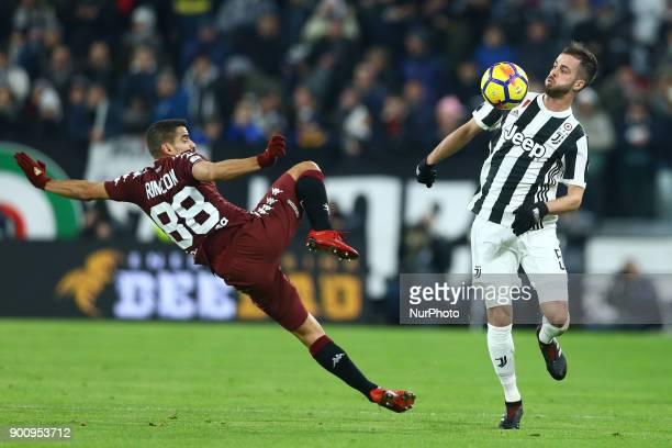 Tomas Rincon of Torino and Miralem Pjanic of Juventus during the TIM Cup match between Juventus and Torino FC at Allianz Stadium on January 3 2018