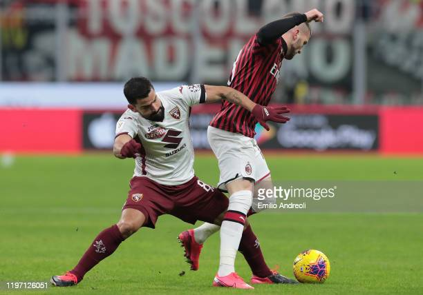 Tomas Rincon of Torino FC competes for the ball with Ante Rebic of AC Milan during the Coppa Italia Quarter Final match between AC Milan and Torino...