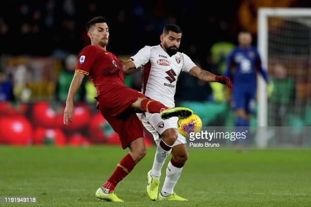 Tomas Rincon of Torino FC competes for the ball with Lorenzo Pellegrini of AS Roma during the Serie A match between AS Roma and Torino FC at Stadio...
