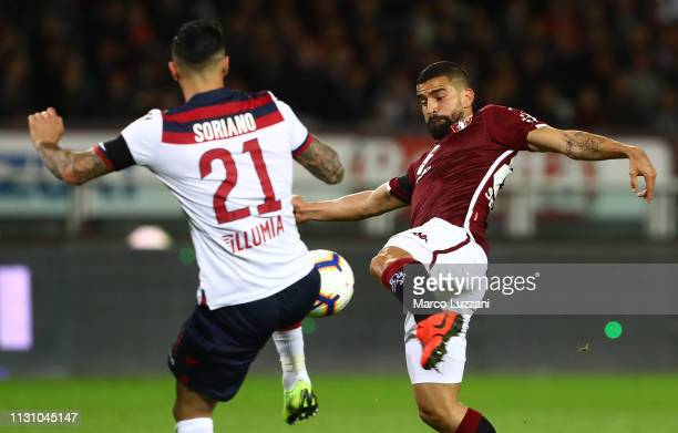 Tomas Rincon of Torino FC competes for the ball with Roberto Soriano of Bologna FC during the Serie A match between Torino FC and Bologna FC at...
