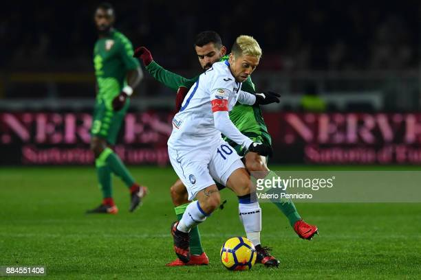 Tomas Rincon of Torino FC competes with Alejandro Gomez of Atalanta BC during the Serie A match between Torino FC and Atalanta BC at Stadio Olimpico...