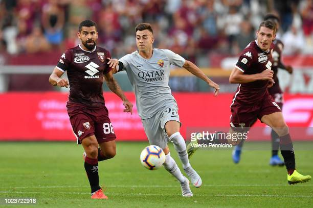 Tomas Rincon of Torino FC competes with Stephan El Shaarawy of AS Roma during the Serie A match between Torino FC and AS Roma at Stadio Olimpico di...