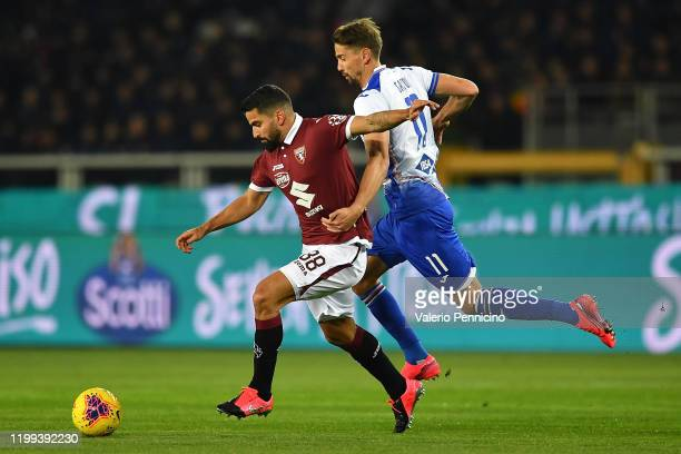Tomas Rincon of Torino FC is challenged by Gaston Ramirez of UC Sampdoria during the Serie A match between Torino FC and UC Sampdoria at Stadio...