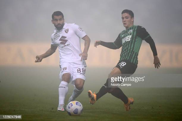 Tomas Rincon of Torino FC is challenged by Giacomo Raspadori of US Sassuolo during the Serie A football match between US Sassuolo and Torino FC The...