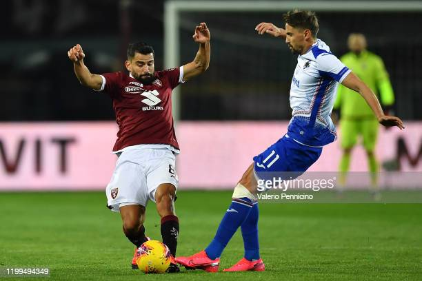 Tomas Rincon of Torino FC is clashes with Gaston Ramirez of UC Sampdoria during the Serie A match between Torino FC and UC Sampdoria at Stadio...
