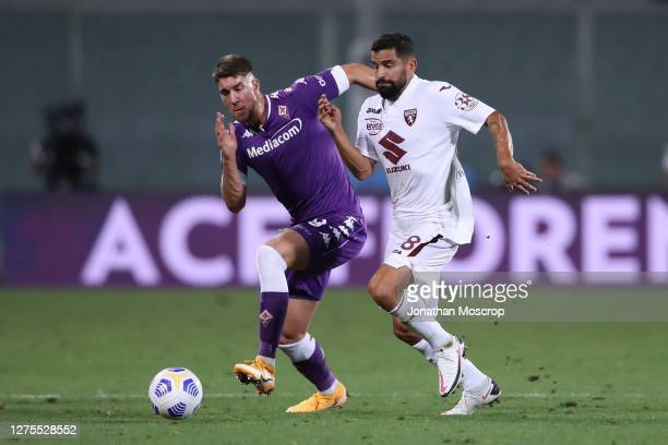 Tomas Rincon of Torino FC takes on Dusan Vlahovic of ACF Fiorentina during the Serie A match between ACF Fiorentina and Torino FC at Stadio Artemio...