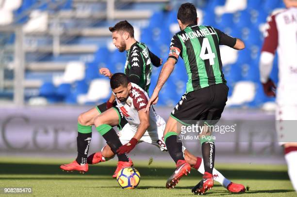 Tomas Rincon of Torino is challenged by Domenico Berardi and Francesco Magnanelli of Sassuolo during the serie A match between US Sassuolo and Torino...