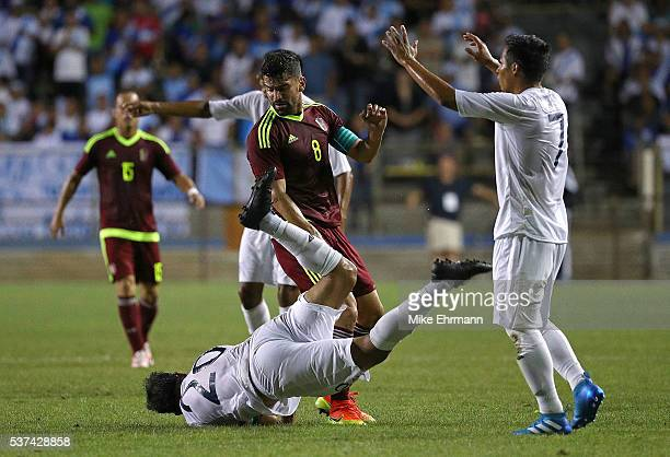 Tomas Rincon of Venezuela and Carlos Humberto Ruiz Gutierrez of Guatamala fight for the ball during a game against Guatamala at Lockhart Stadium on...
