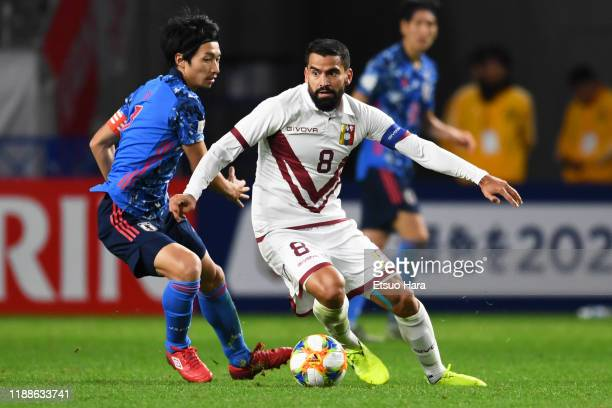 Tomas Rincon of Venezuela and Gaku Shibasaki of Japan compete for the ball during the international friendly match between Japan and Venezuela at the...