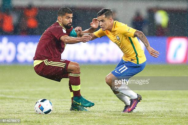 Toma‡s Rinco—n of Venezuela and Philippe Coutinho of Brazil fight for the ball during a match between Venezuela and Brazil as part of FIFA 2018 World...