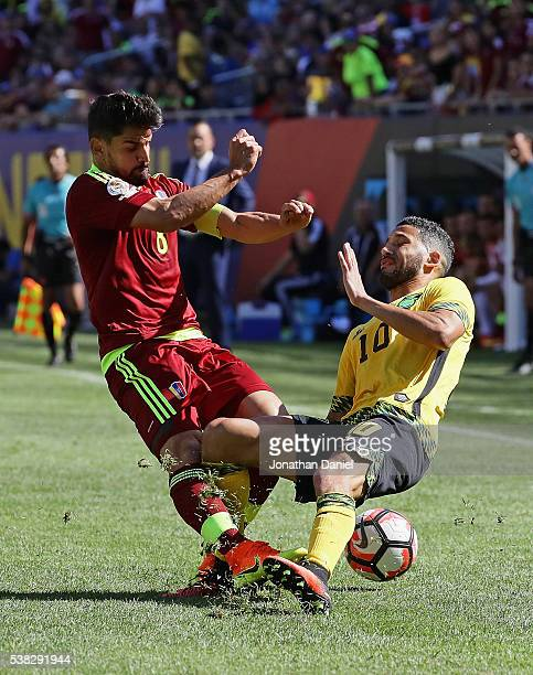 Tomas Rincon of Venezuela collides with Jobi McAnuff of Jamaica during a match in the 2016 Copa America Centenario at Soldier Field on June 5 2016 in...