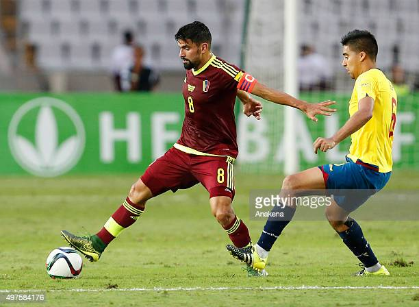 Tomas Rincon of Venezuela fights for the ball with Christian Noboa of Ecuador uring a match between Venezuela and Ecuador as part of FIFA 2018 World...