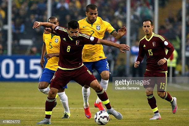 Tomas Rincon of Venezuela fights for the ball with Dani Alves of Brazil during the 2015 Copa America Chile Group C match between Brazil and Venezuela...