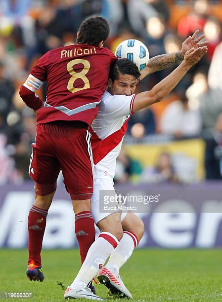 Tomas Rincon of Venezuela struggles for the ball with Jose Paolo Guerrero ofm Peru during the Copa America 2011 third place match between Venezuela...