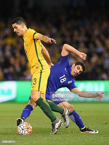 Tomas Rogic of Australia and Petros Mantalos of Greece compete for the ball during the International Friendly match between the Australian Socceroos...