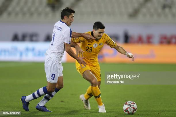 Tomas Rogic of Australia battles for possession with Odil Ahmedov of Uzbekistan during the AFC Asian Cup round of 16 match between Australia and...