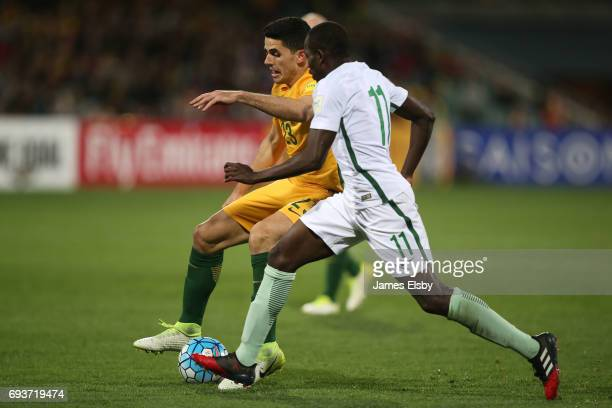 Tomas Rogic of Australia competes with Abdulmalek Al Khaibri of Saudi Arabia during the 2018 FIFA World Cup Qualifier match between the Australian...