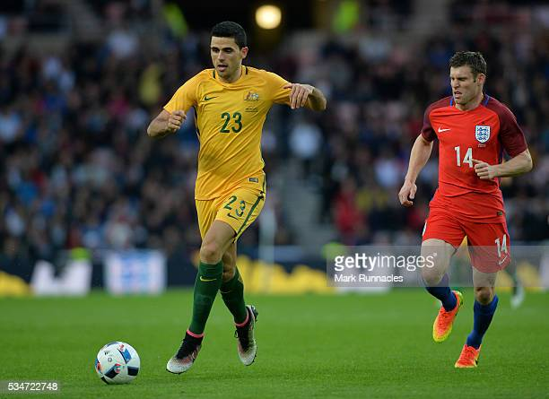 Tomas Rogic of Australia out runs James Milner of England during the International Friendly match between England and Australia at Stadium of Light...