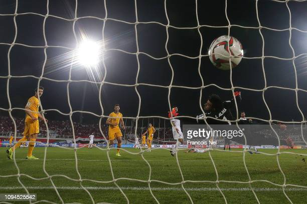Tomas Rogic of Australia scores the winning goal as goalkeeper Ibrahim Alma of Syria dives in vain during the AFC Asian Cup Group B match between...