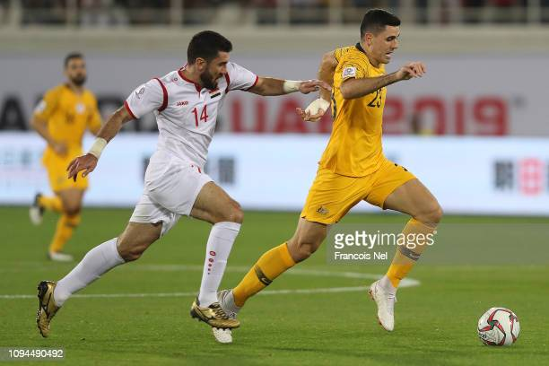 Tomas Rogic of Australia tracked by Tamer Hag Mohamad of Syria during the AFC Asian Cup Group B match between Australia and Syria at Khalifa Bin...