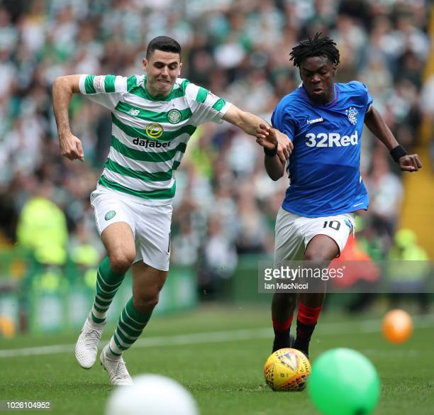Tomas Rogic of Celtic battles for possession with Ovie Ejaria of Rangers during the Scottish Premier League match between Celtic and Rangers at...