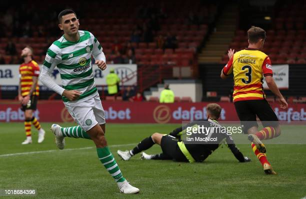 Tomas Rogic of Celtic celebrates after scores his team's third goal during the Betfred Scottish League Cup round of sixteen match between Partick...