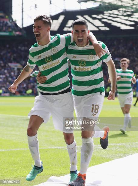 Tomas Rogic of Celtic celebrates after scoring his sides fourth goal with Mikael Lustig of Celtic during the Scottish Premier League match between...