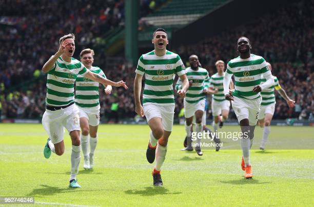 Tomas Rogic of Celtic celebrates scoring his team's fourth goal during the Scottish Premier League match between Celtic and Rangers at Celtic Park on...