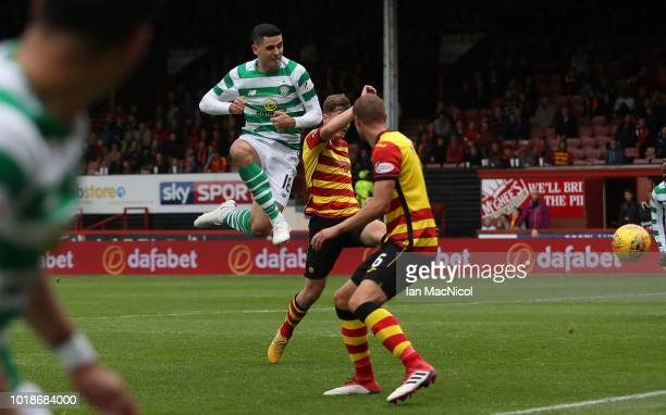 Tomas Rogic of Celtic scores his team's third goal during the Betfred Scottish League Cup round of sixteen match between Partick Thistle and Celtic...