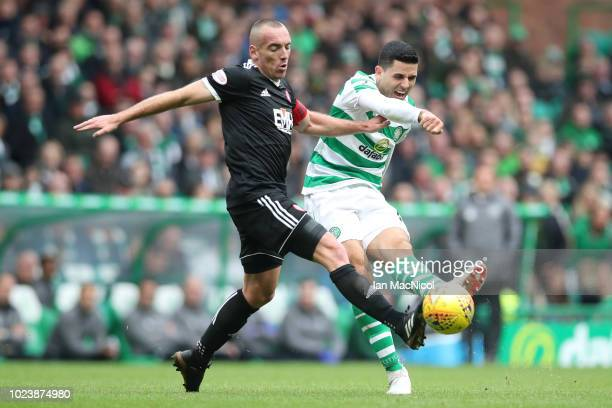 Tomas Rogic of Celtic shoots while under pressure during the Scottish Premier League match between Celtic and Hamilton at Celtic Park Stadium on...