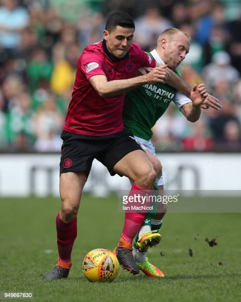 Tomas Rogic of Celtic vies with Dylan McGeouch of Hibernian during the Ladbrokes Scottish Premiership match between Hibernian and Celtic at Easter...