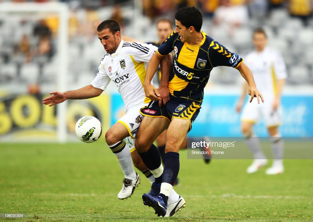 Tomas Rogic of the Mariners competes with Emmanuel Muscat of the Phoenix during the round 20 A-League match between the Central Coast Mariners and the Wellington Phoenix at Bluetongue Stadium on February 18, 2012 in Gosford, Australia.