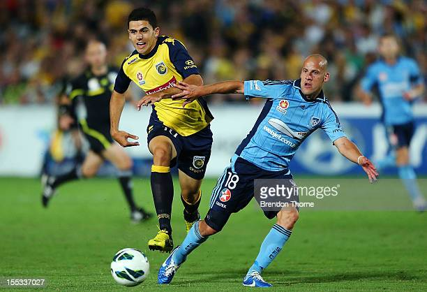Tomas Rogic of the Mariners competes with Trent McClenahan of Sydney during the round five ALeague match between the Central Coast Mariners and...