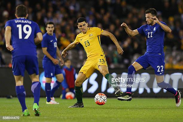 Tomas Rogic of the Socceroos and Andreas Samaris of Greece compete for the ball during the International Friendly match between the Australian...