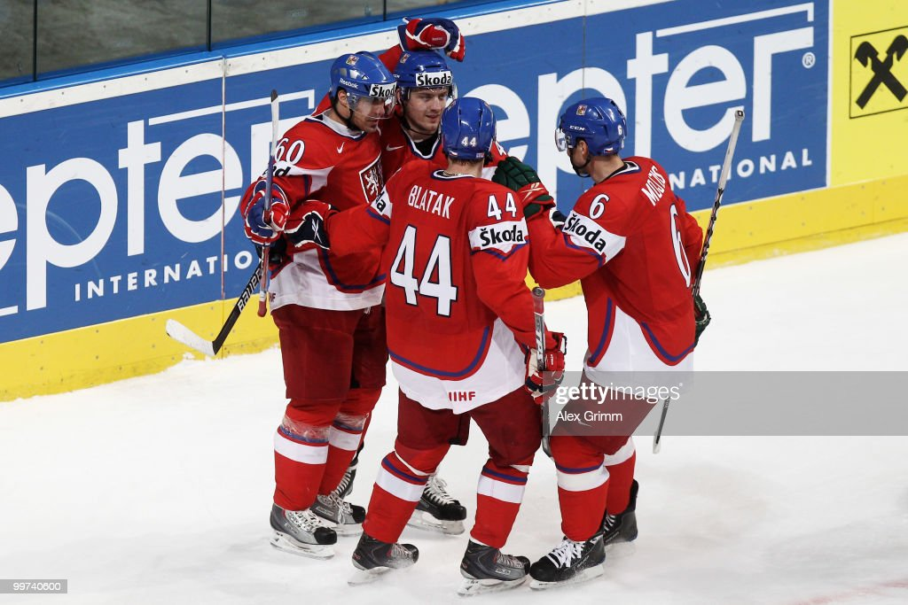 Tomas Rolinek of Czech Republic celebrates his team's second goal with team mates Petr Koukal, Miroslav Blatak and Tomas Mojzis (L-R) of Czech Republic during the IIHF World Championship group F qualification round match between Czech Republic and Latvia at SAP Arena on May 17, 2010 in Mannheim, Germany.